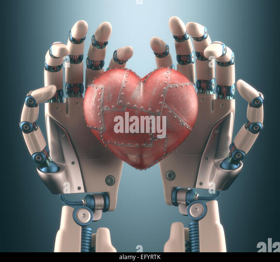 Robot hand holding a metal heart. Clipping path included. - Stock Image
