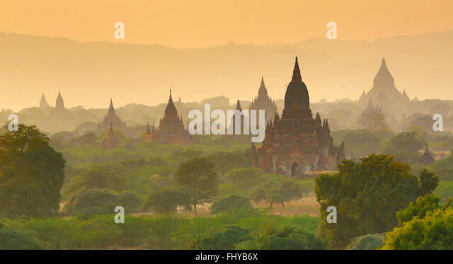 Temples and pagodas at sunset on the Central Plain of Bagan, Myanmar (Burma) - Stock Image