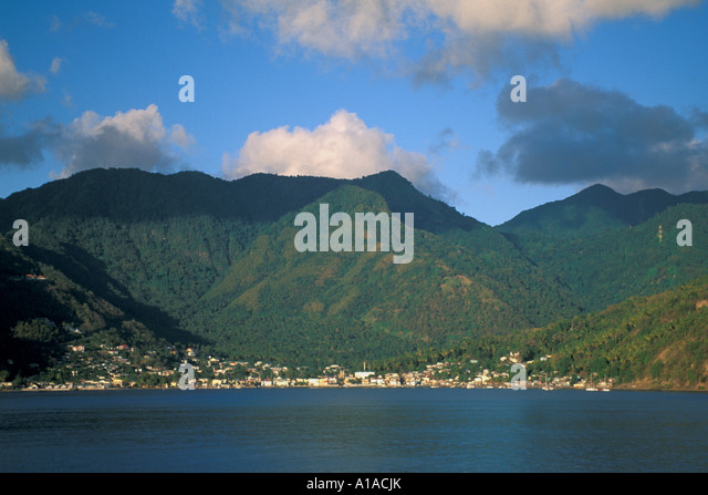 St Lucia shoreline mountains rain forest Soufriere town - Stock Image