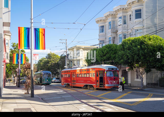 Vintage F-line streetcars on 17th Street (17th Street Plaza) in the Castro District of San Francisco, California. - Stock Image