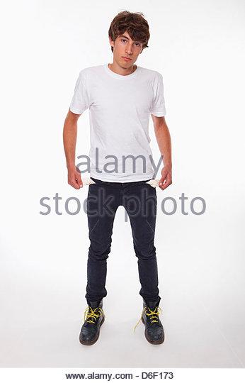 Poor teenager male empty pockets depressed broke - Stock Image