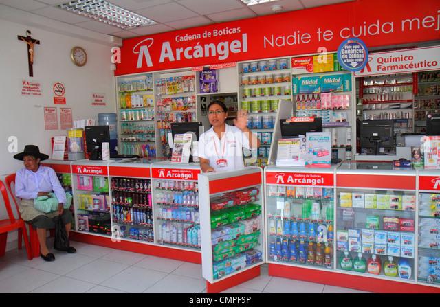 Peru Tacna Avenida San Martin Boticas Archangel shopping pharmacy drug store medicine healthcare counter Hispanic - Stock Image