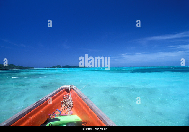 Snorkel dive fins mask colorful old boat iconic tropical image - Stock Image