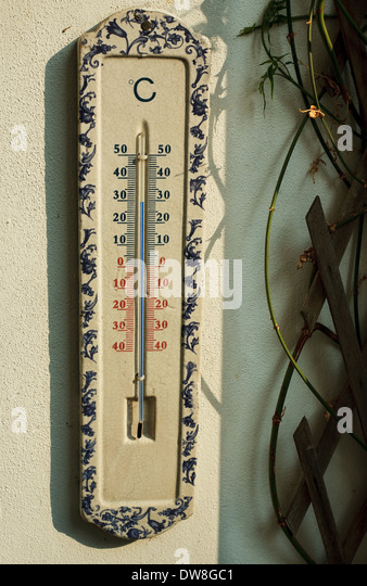 Outside ceramic wall thermometer 30 degrees centigrade - Stock Image