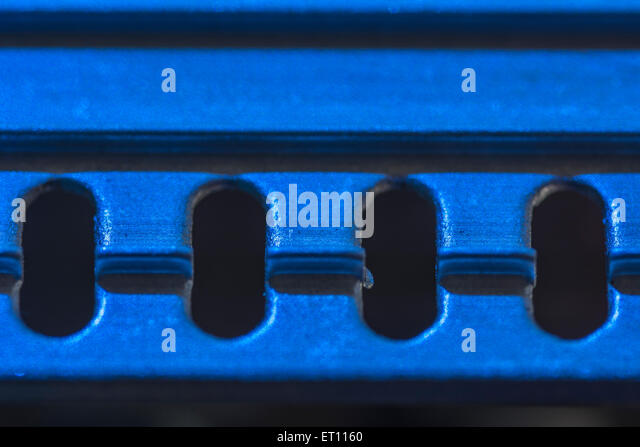 Macro-photo of section of cooling heat-sink from a PC PSU - 3 IC's o/ transistors out of sight below. - Stock Image