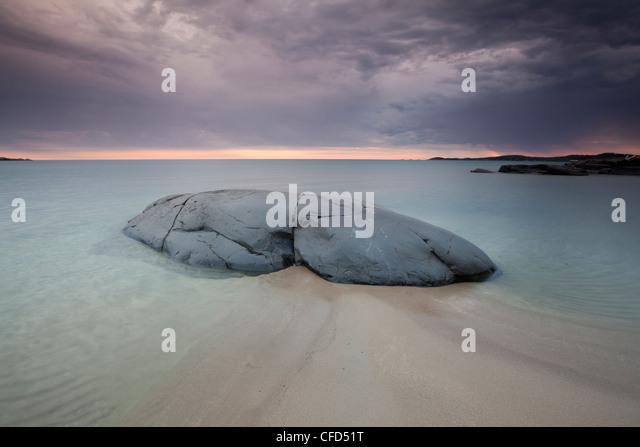 Moody evening light at North Beach on the shores of Lake Superior in Pukaskwa National Park, Ontario, Canada - Stock Image