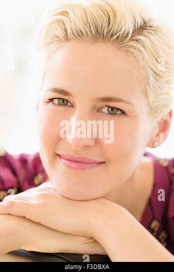 Portrait of young woman indoors - Stock Image
