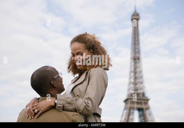 African couple smiling at each other - Stock-Bilder
