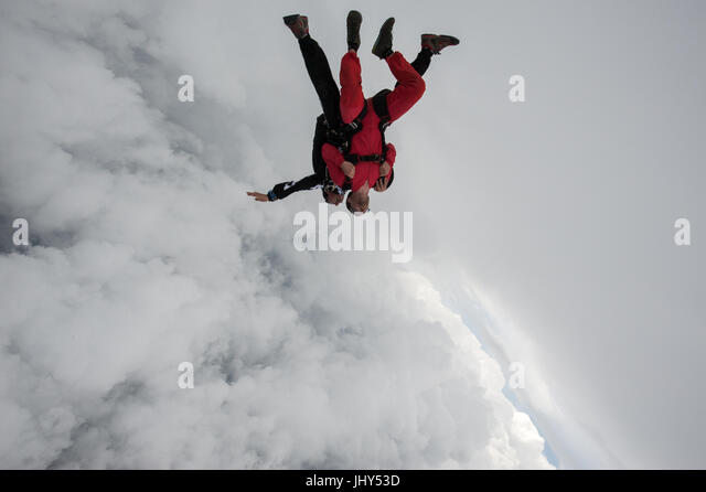 A tandem instructor taking a passenger for his first skydive - Stock Image
