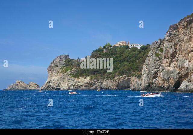 View from the sea to Panagia Theotokou monastery above Paleokastritsa Bay, Corfu island, Ionian islands, Greece - Stock Image