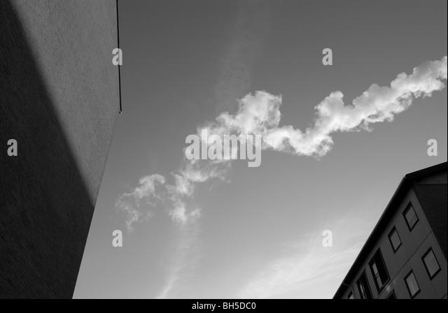 SMOKE BETWEEN BUILDINGS - Stock Image
