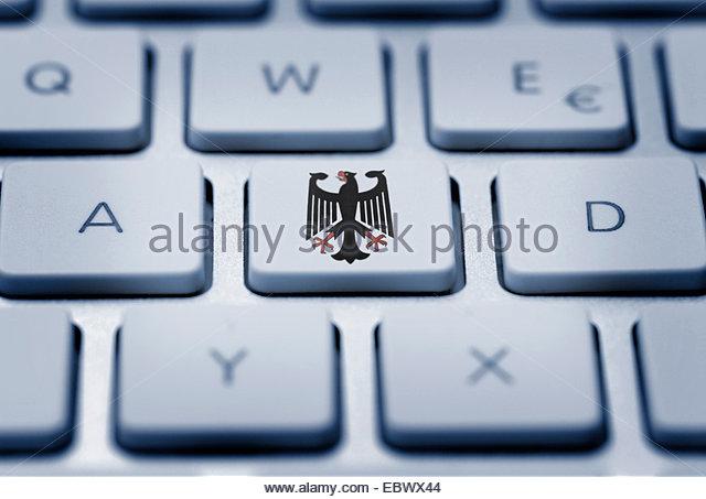 Federal Eagle on key pad, spyware - Stock Image