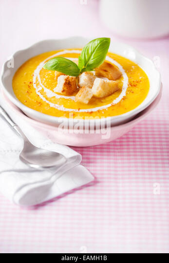 Pumpkin soup with croutons and basil - Stock-Bilder