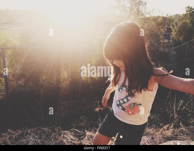 Girl Looking Down On Field - Stock-Bilder