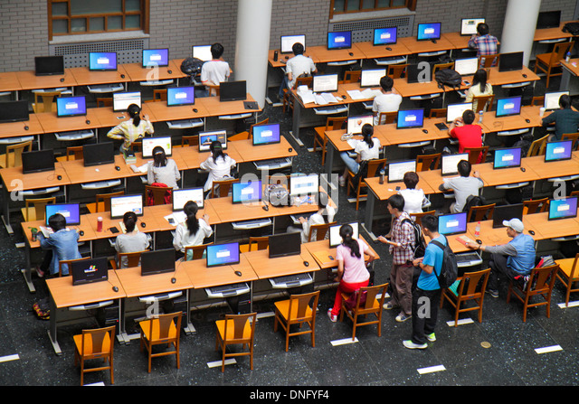 Beijing China Haidian District Peking University PKU Beidà higher education campus library study hall computer - Stock Image