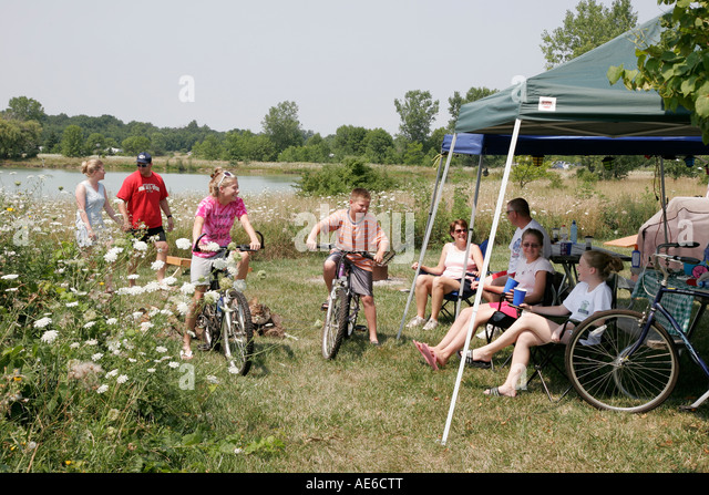 Toledo Ohio Oregon Maumee Bay State Park campground family bicycle tent - Stock Image