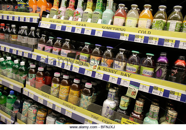 Miami Beach Florida Walgreen's Pharmacy drug store chain business refrigerator shelf shelves cold drinks iced - Stock Image