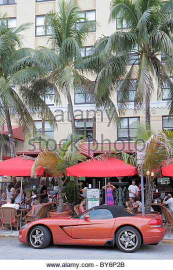 Miami Beach Florida Art Deco District Ocean Drive convertible sports car Dodge Viper restaurant alfresco dining - Stock Image