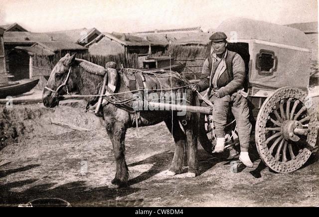 Chinese rickshaw puller. - Stock Image