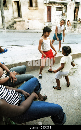 Santiago de Cuba, Cuba, girl dancing on the street - Stock Image