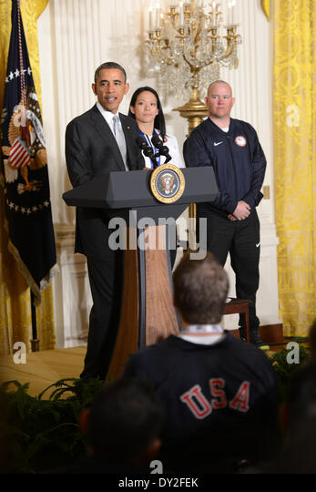 US President Barack Obama speaks during a ceremony to honor Paralympic and Olympic athletes in the East Room of - Stock Image