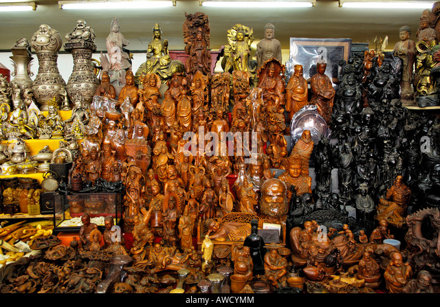 Wooden carvings in craft stall stock photos