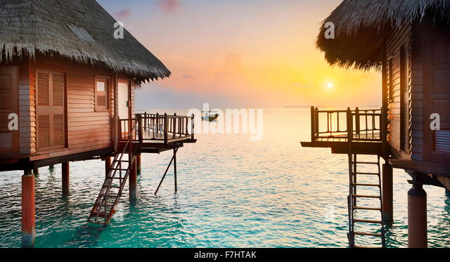Tropical sunset scenery at Maldives Islands - Stock Image