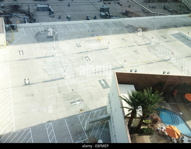 USA, Nevada, Clark County, Las Vegas, Swimming pool with car parking below - Stock Image