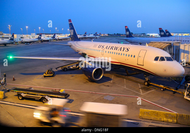 North Carolina Charlotte Charlotte Douglas International Airport CLT terminal concourse gate area tarmac US Airways - Stock Image