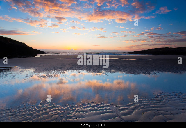Evening beach reflections, False Bay, Connemara, Co Galway, Ireland. - Stock Image
