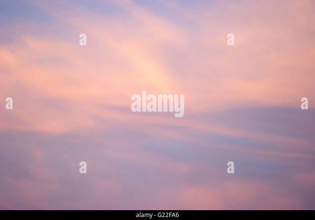 a poetic picture of the pink and blue sky with clouds at sunset, Palma de Mallorca, Spain, seaside, tourism, holidays, - Stock Image