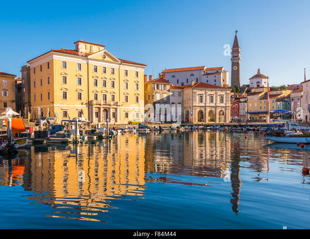 Venetian Port and The Main Square Tartini of Piran City Reflected on Water in Slovenia. - Stock Image