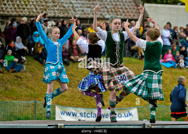 Girls dancing in kilts at the Ceres Highland Games folk dance competition, Ceres, Scotland, United Kingdom - Stock Image