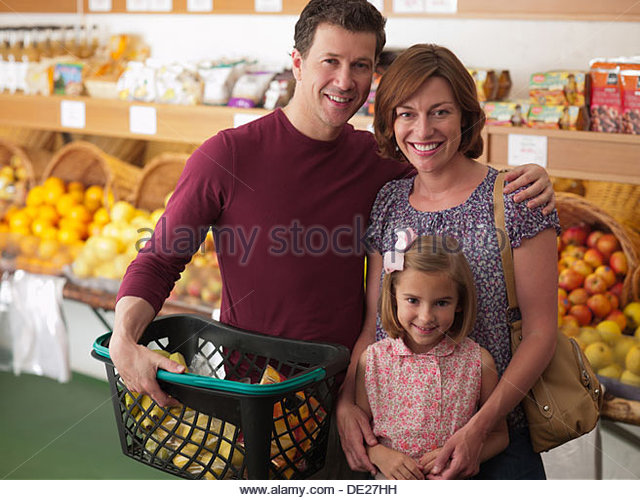 Family shopping together in grocery store - Stock Image
