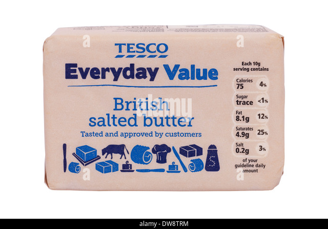 A block of Tesco British salted butter on a white background - Stock Image