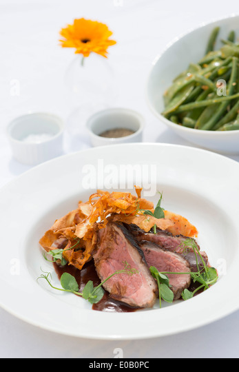 Beef and parsnip crisps, served with lambs lettuce. - Stock Image