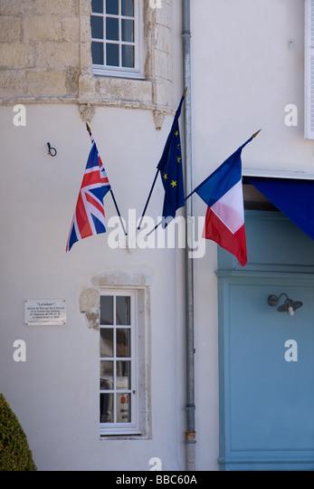 Windows Shutters and Flags in St Martin en Ré Île de Ré Poitou Charente France - Stock-Bilder