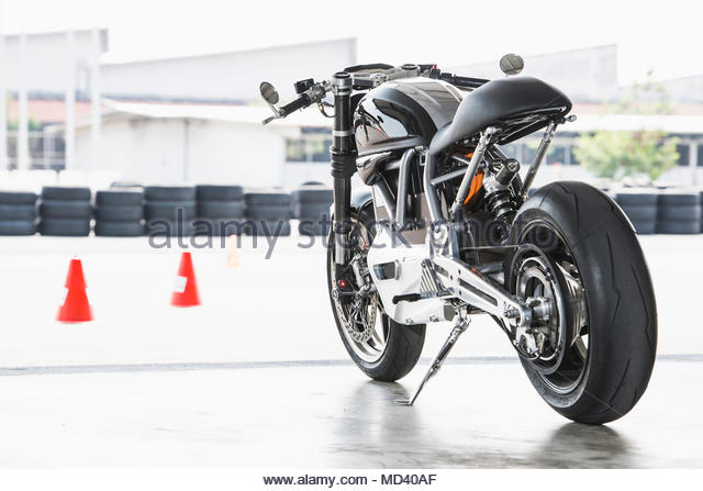 Electric cafe racer motorbike on race track - Stock Image