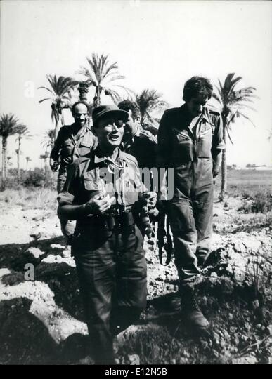 Feb. 24, 2012 - Yom Kippur War 1973: Moshe Dayan on the Egyptian side of the Suez Canal - eating dates. - Stock Image