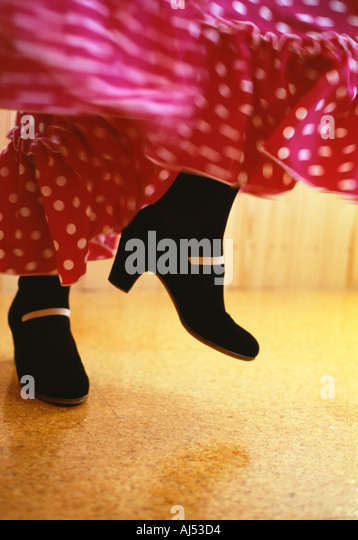 Flamenco movements feet and swirling skirt Spain - Stock Image