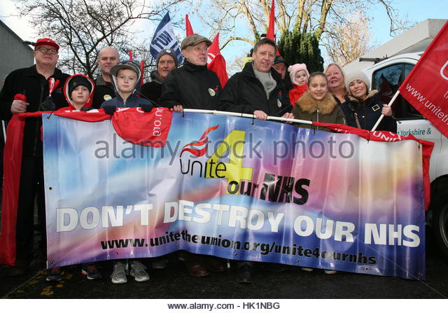 Newcastle, UK. 4th Feb, 2017. Protesters hold banner during a demonstration to defend National Health Service (NHS) - Stock Image