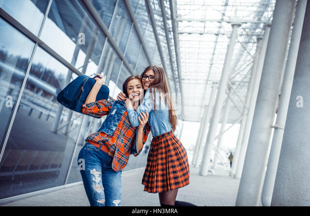 Girls having fun and happy when they met at the airport.Art proc - Stock Image