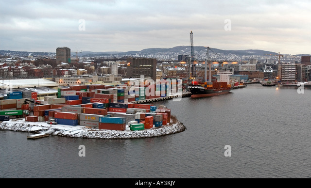 Container ship moored at quay in the harbour of Oslo, Norway during a grey winter day. - Stock Image