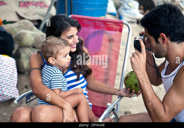 Mother and son, father taking photograph - Stock-Bilder