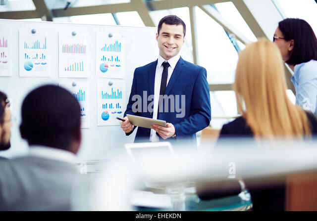 Chief gathering his managers for the meeting - Stock Image