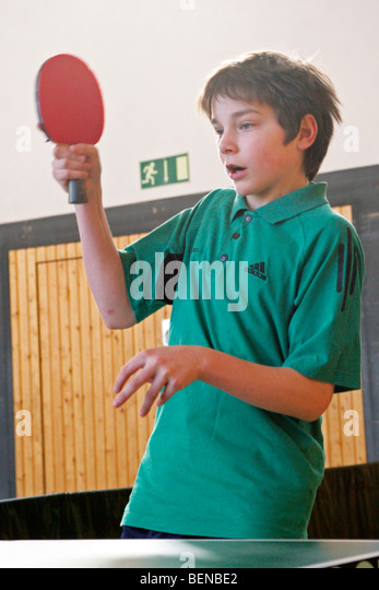 young boy playing table tennis - Stock Image