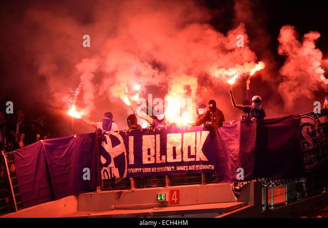 Hooligans, flares, pyrotechnics, masked people in the fan block, Mercedes-Benz Arena, Stuttgart, Baden-Württemberg, - Stock Image