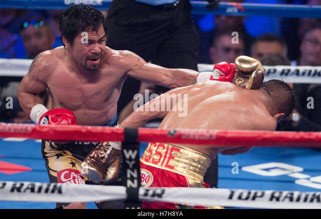 Las Vegas, USA. 5th Nov, 2016. Manny Pacquiao (L) of the Philippines punches Jessie Vargas during the WBO welterweight - Stock Image