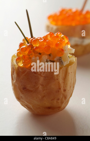 Potato and trout roe appetizers - Stock Image
