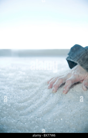 frozen hand lying on snow and ice. exterior location, - Stock Image